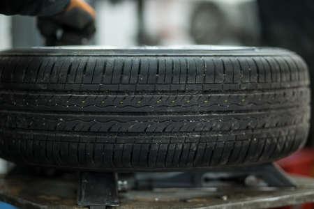 tread: Car tire tread in maintenance