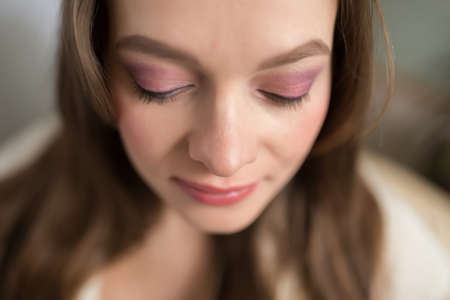 Closeup of young adult darling woman face with day makeup Stock Photo