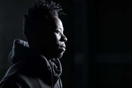 African man profile portrait in dark Stock fotó