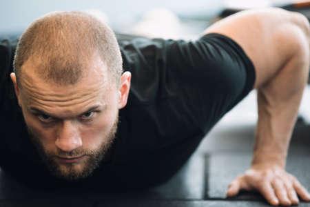 Man push ups in gym