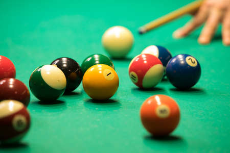 Billiards balls and cue Banque d'images