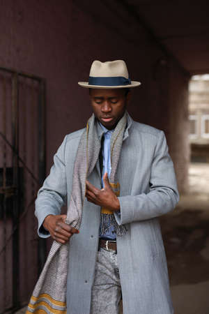 African american man portrait wearing a scarf in urban city