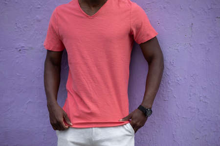 Empty living coral t-shirt on the African male body, blank shirt for mockup
