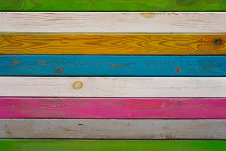 Wooden desks, colorful planking surface