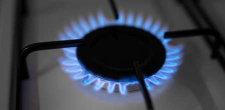 Natural gas flame burning on kitchen stove