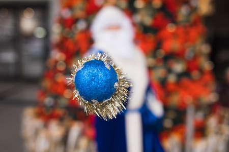 Blue Santa showing his stick celebrating Christmas holiday, abstract photo