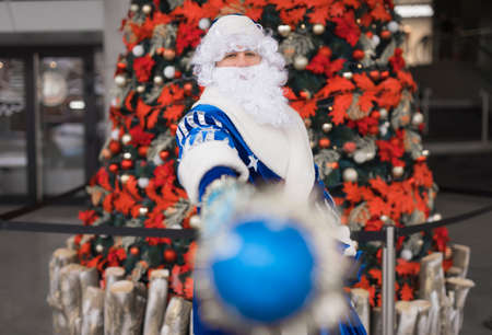 Blue Santa showing his stick celebrating Christmas holiday