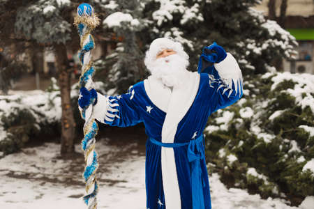 Blue Santa celebrating New Year holiday in the winter city