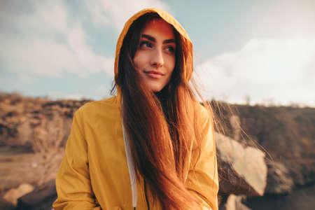 Traveler woman portrait sitting on the nature near quarry Stock Photo