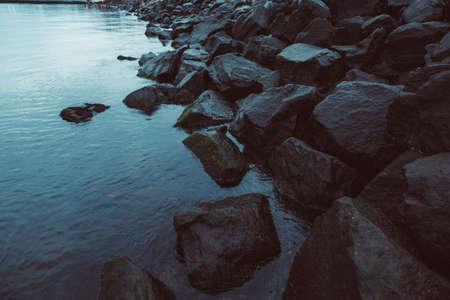 Big stones in the sea, toned photo Stock Photo