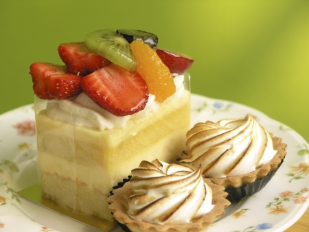Close up of cake with colorful fruits and background photo