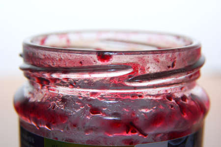 Empty glass of red jam photo