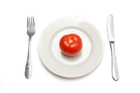 Tomato on white plate  Stock Photo - 12685466