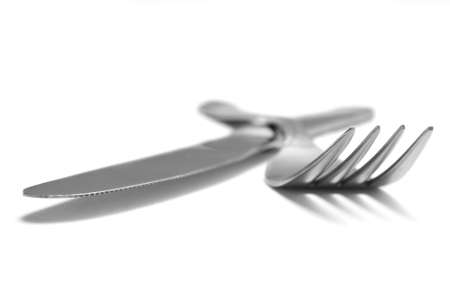 Cutlery on white background photo