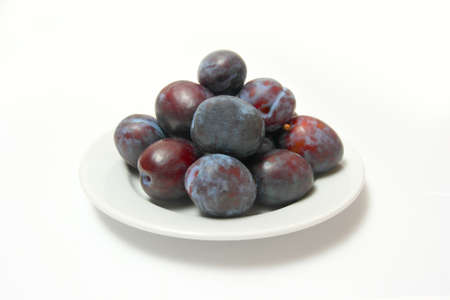 Plums on white plate  Stock Photo - 12685705