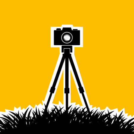 photo camera: Silhouette of camera on orange background