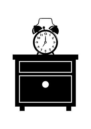 Reloj de alarma sobre la mesita de noche