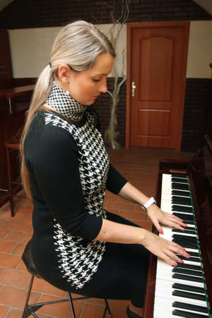 keyboard player: Woman and piano Stock Photo