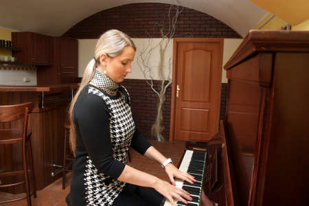 Woman and piano photo