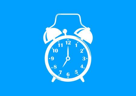 White alarm clock on blue background