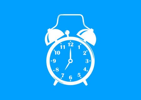 White alarm clock on blue background