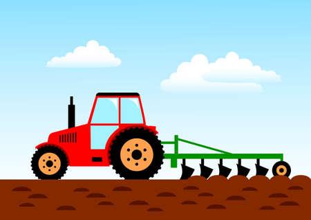 Praca w rolnictwie, czerwony traktor na polu