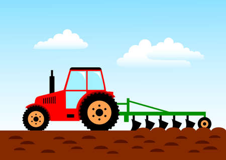 Agricultural work, red tractor on field