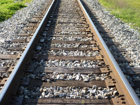 a perspective shot ,color image of train track outdoors with a high angle view Stock fotó