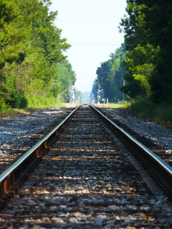 verticals: train tracks leading off in the distant Stock Photo