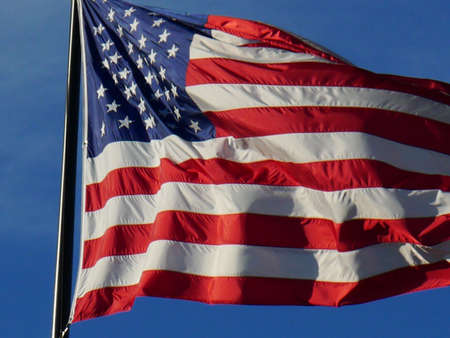 the flag flying in the wind Stock Photo