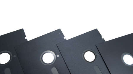 Old original five and a quarter inch floppy disk border isolated on white.