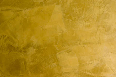 Old style golden plaster in Venetian or Mediterranean tradition. Useful for texture or background applications.