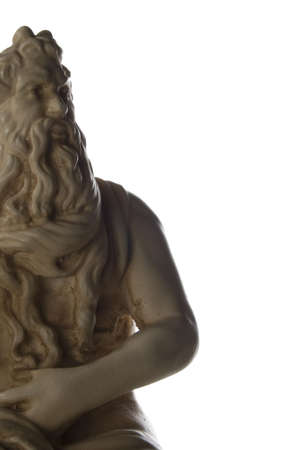 This iconic statue is likely of the Greek god Zeus. A reproduction of a classical Greek sculpture. Isolated on white. photo