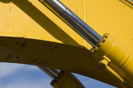 hydraulics: Paired hydraulics on an excavator arm. Stock Photo