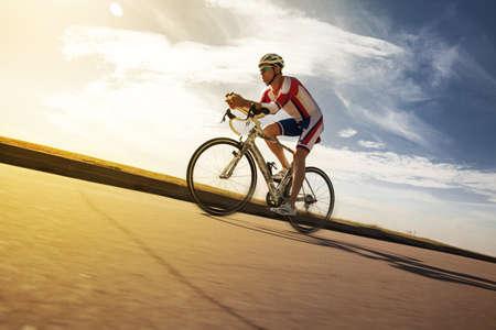 Cyclist overtaking a breeze. Triathlon 스톡 콘텐츠