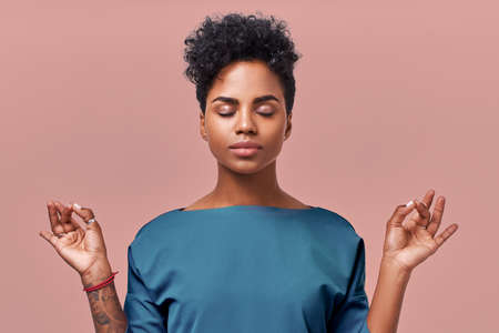 Calm woman relaxing meditating, no stress free relief at work concept, mindful peaceful young businesswoman or doctor practicing breathing yoga exercises on isolated over beige background
