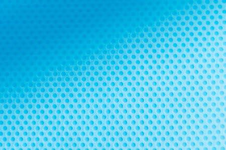 Light blue pool bottom polka dot texture. Summer concept.