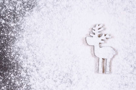 Christmas and holidays background. Silhouette of little deer in christmas snowfall. New Year is coming concept. Copy space. Standard-Bild