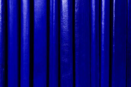 Dark blue book covers background. Books spines on shelf. Education and school concept. Standard-Bild