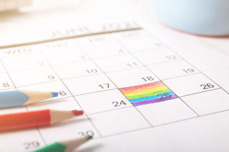 June 25, 2021 is rainbow flag day. painted in calendar the symbolic colors of the flag.