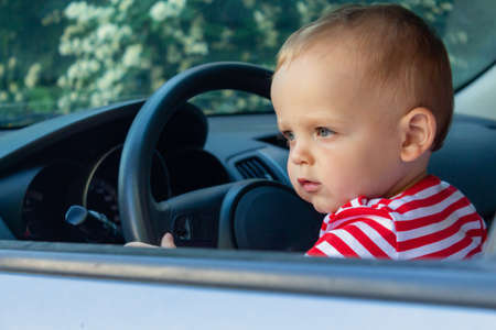 Baby boy driver. Travel with kids concept.