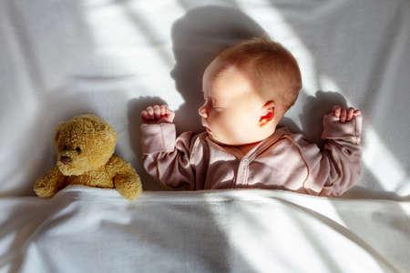 Newborn baby sleeping home with first toy. Standard-Bild