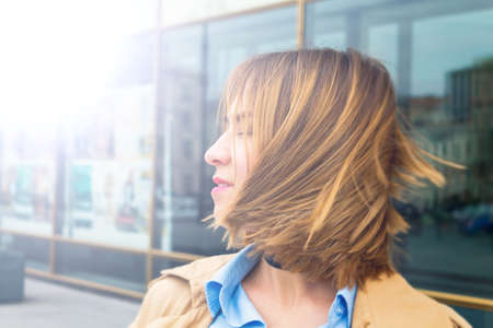 Woman with closed eyes smiling new day.