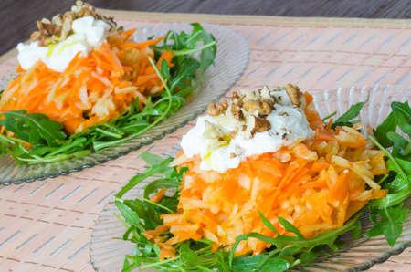 Carrot and apple salad with yogurt and walnuts  Banco de Imagens