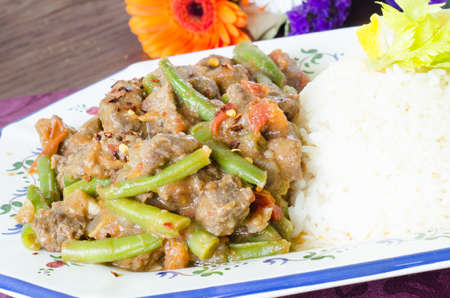 Mexican meat stew with green beans, tomato and rice photo