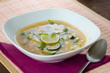 Chicken soup with lemon and rice photo
