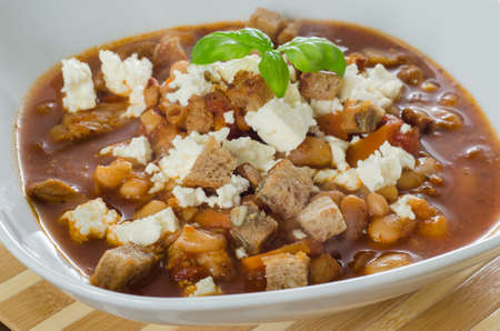 Bean soup with bread and cheese photo