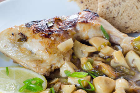 Chicken with mushrooms photo
