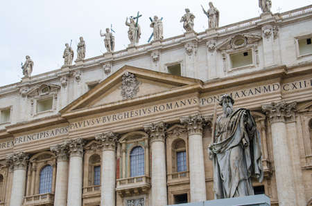 st peter s basilica: Sculpture of st  Paul with the St  Peter s basilica seen from st  Peter s square in the Vatican