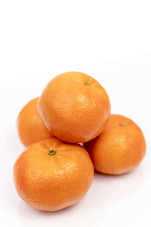 Isolated Tangerines Above White Background With Copy Space. 版權商用圖片